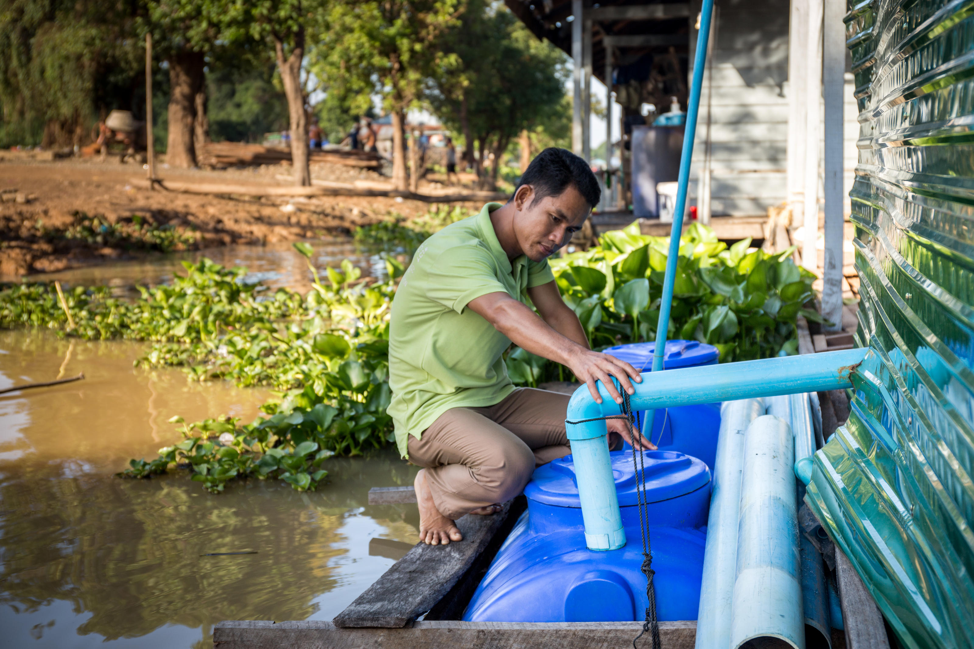 Ke Hakley, 37, with his modified amphibious HandyPod design, at home in the Phat Sanday floating village, Sturng Sen River, Tonle Sap Lake, Cambodia, Feb 2017