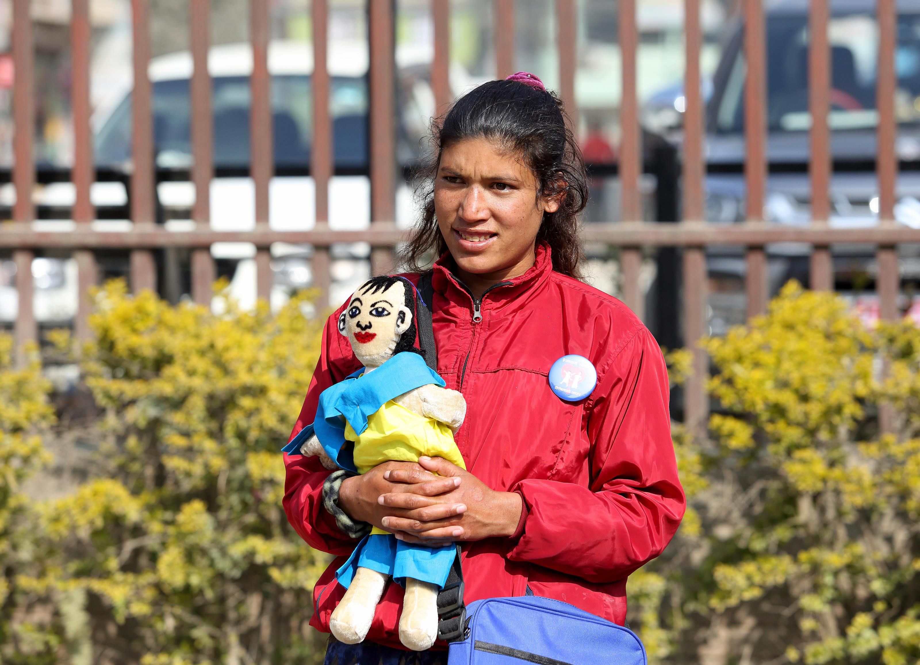 One of the young people who took part in the pilot campaign, carrying a 'Bishesta' doll, outside Banepa Muncipality office, Banepa, Nepal.
