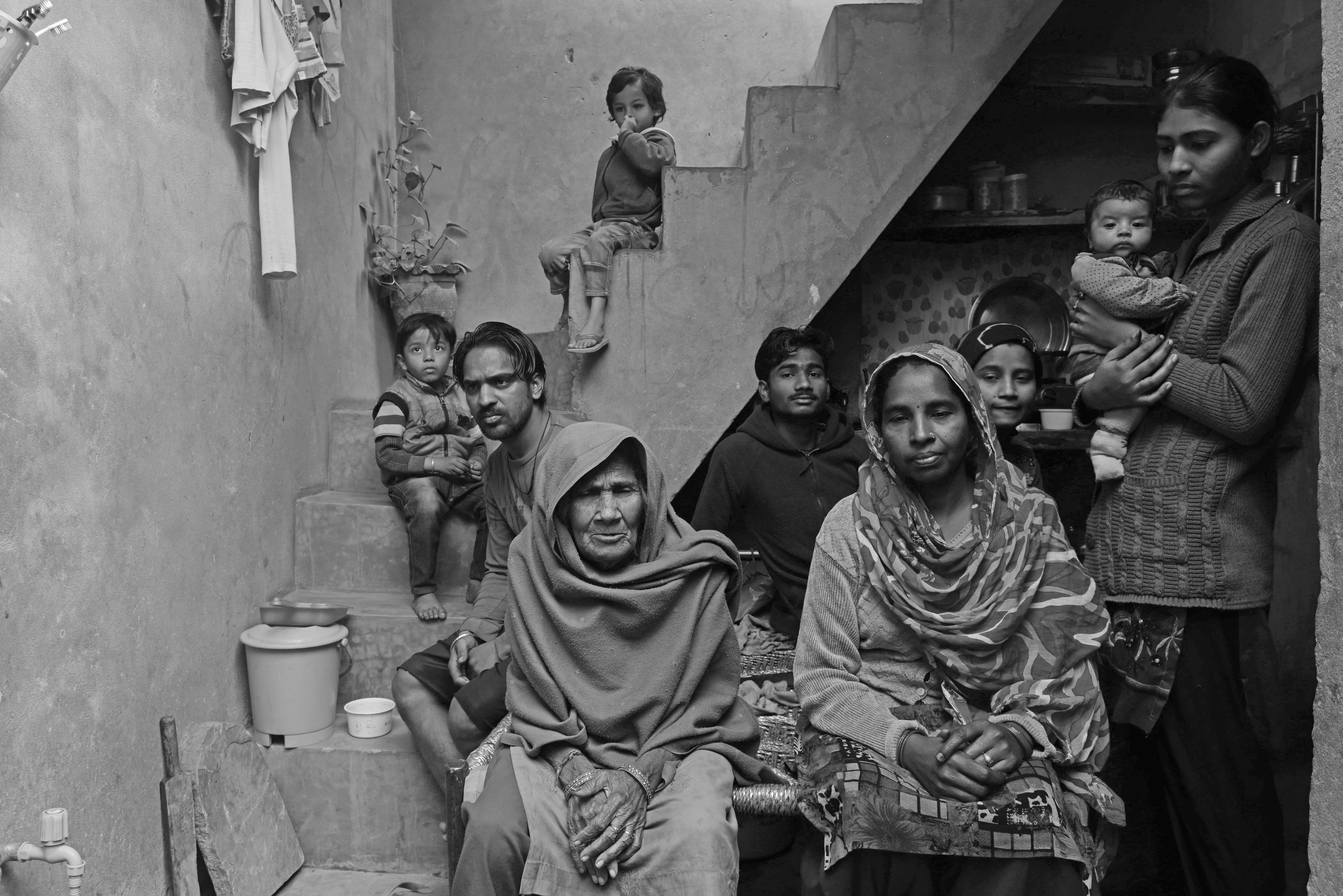 Mukeshdevi and her family at home. She and her husband Sukhraj must empty toilets by hand to support her mother-in-law, five children and two grandchildren.