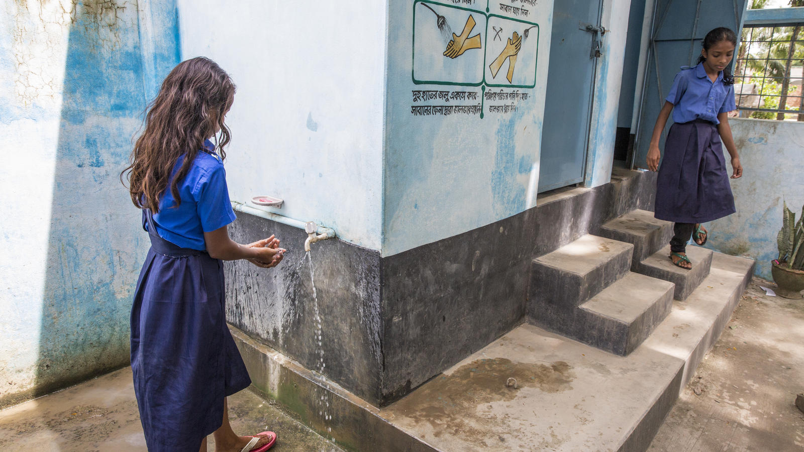 Students at Kalaroa Govt. Primary School in Bangladesh use new toilet facilities with clean running water.