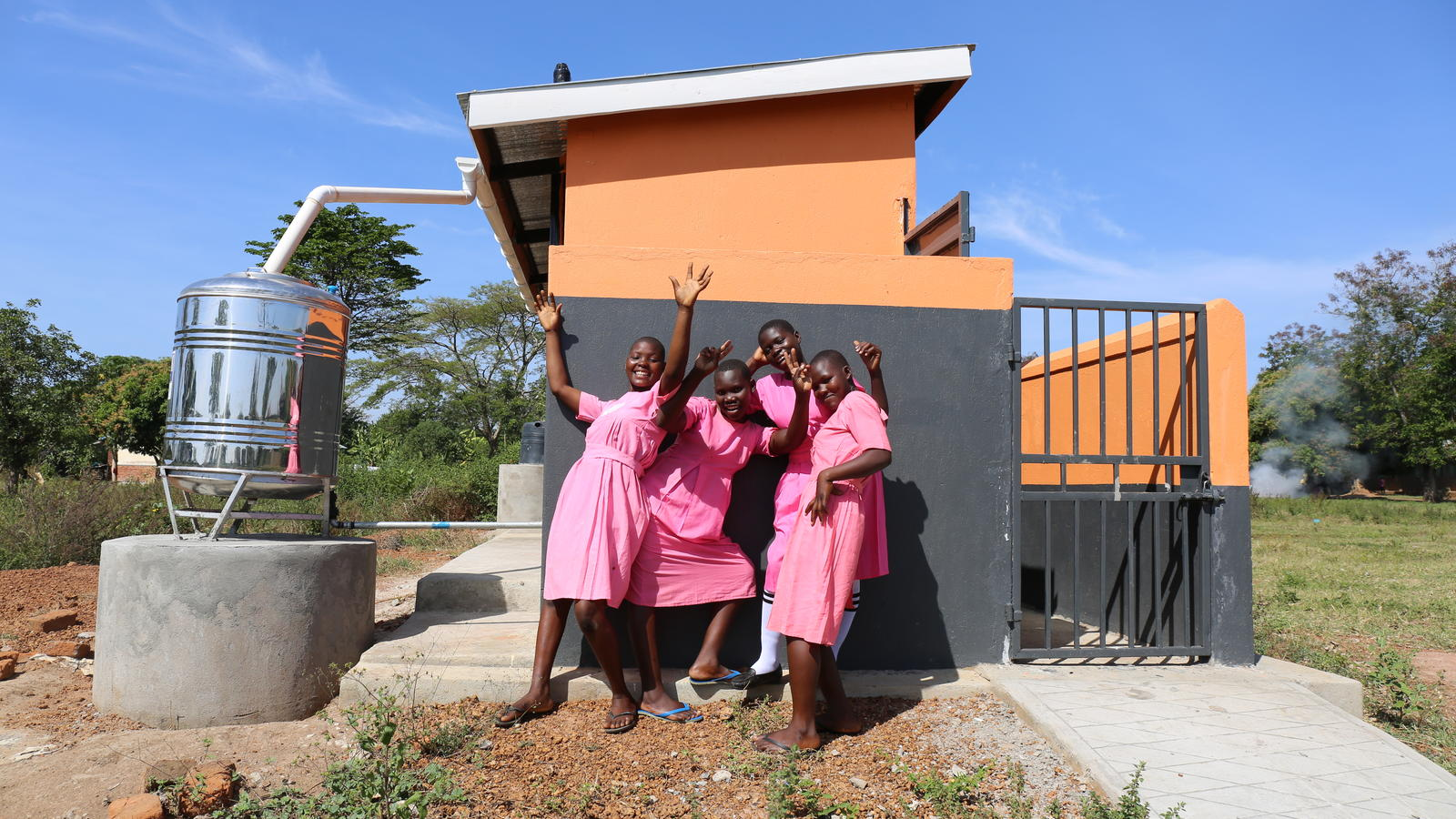 Girls celebrate their newly constructed latrine block in Kibuku district, Uganda, which was funded by H&M foundation.