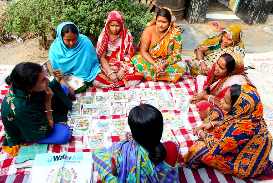 Women from the management committee meet with community members to discuss hygiene and sanitation education, Kalshi Takar Baa slum, Dhaka, Bangladesh.