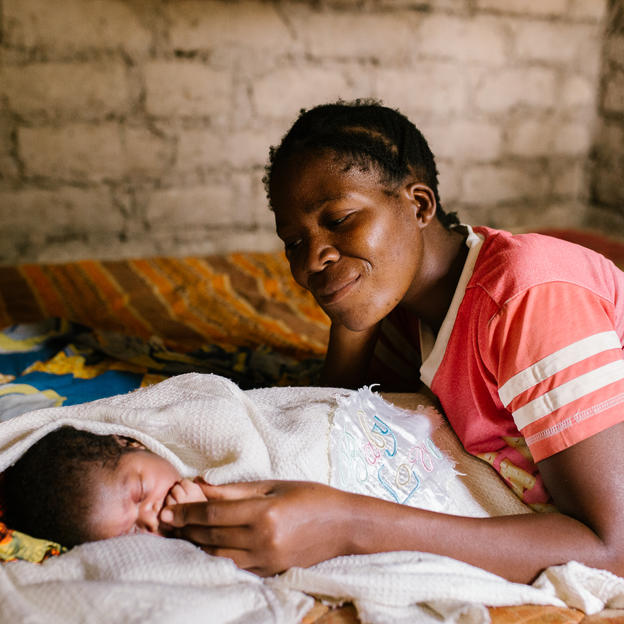 Eva with her baby daughter, Neema, one day old, at home. Without a clean water source the baby remains at high risk of infection. Geita District, Tanzania.