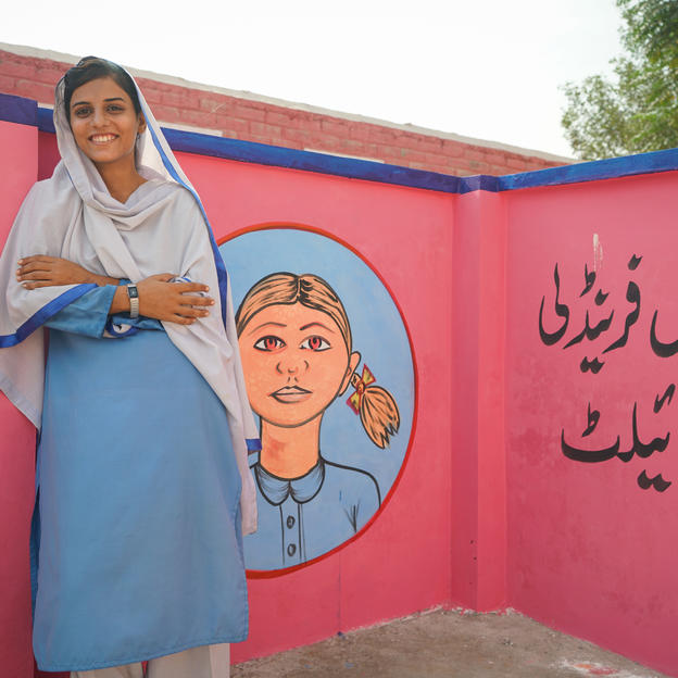 Kishwar in front of the girl-friendly washroom in Province Punjab, Pakistan