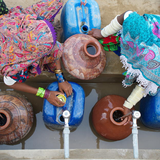 Women fetching water from a WaterAid-installed water tank in District Tharparkar, Pakistan.
