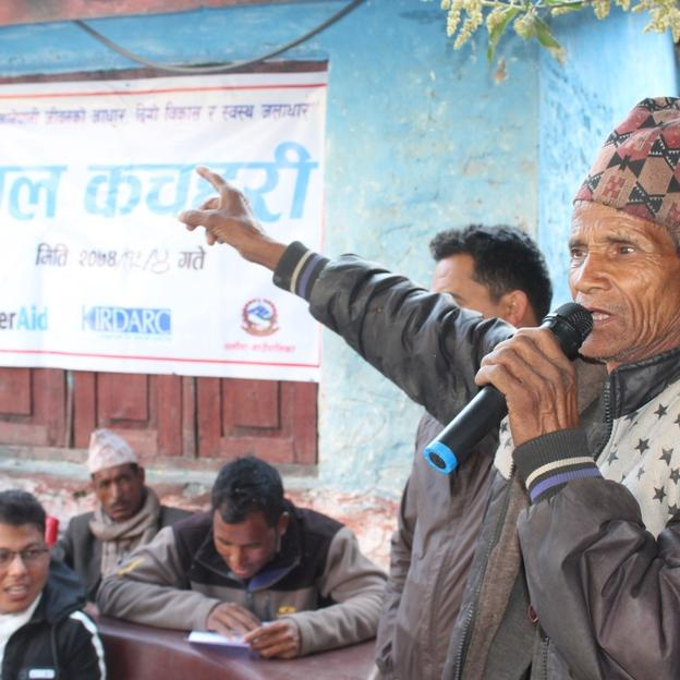A local traditional healer raises a question in a community meeting in Kalikot, Nepal.