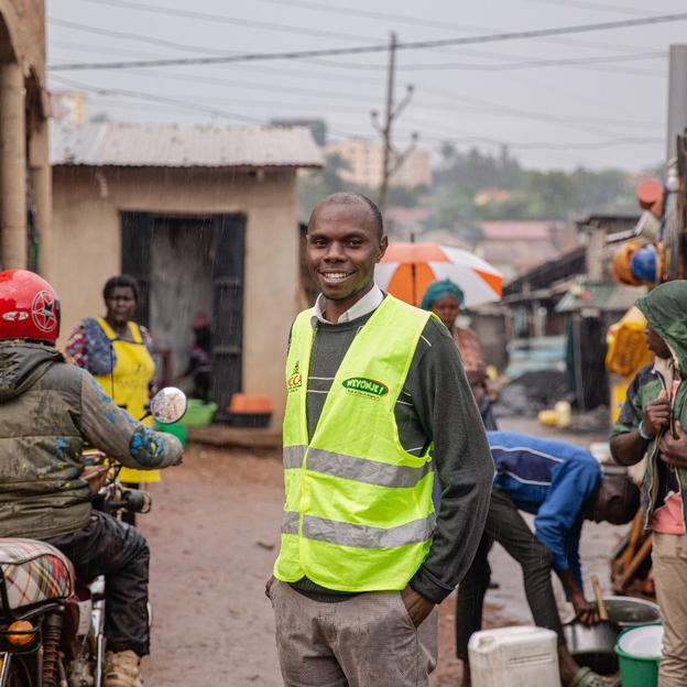 Chris Tumwine standing in the street in Kampala, Uganda.