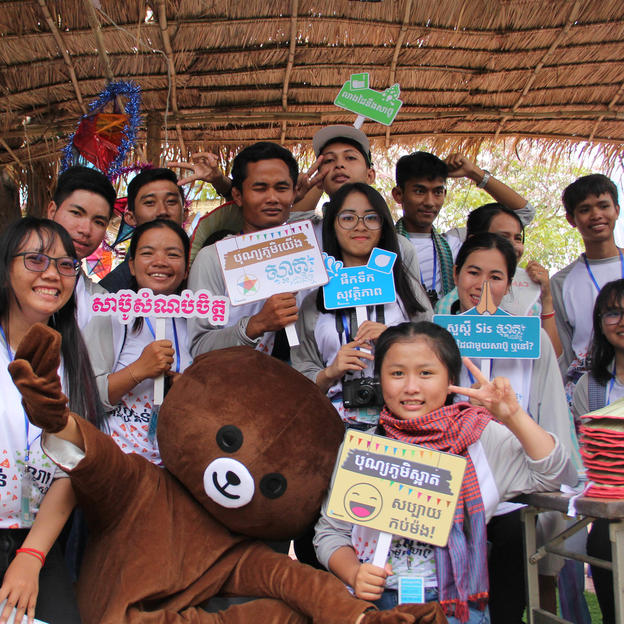 Youth volunteers pose at the WaterAid stand at the 2019 Bonn Phum festival in Cambodia.