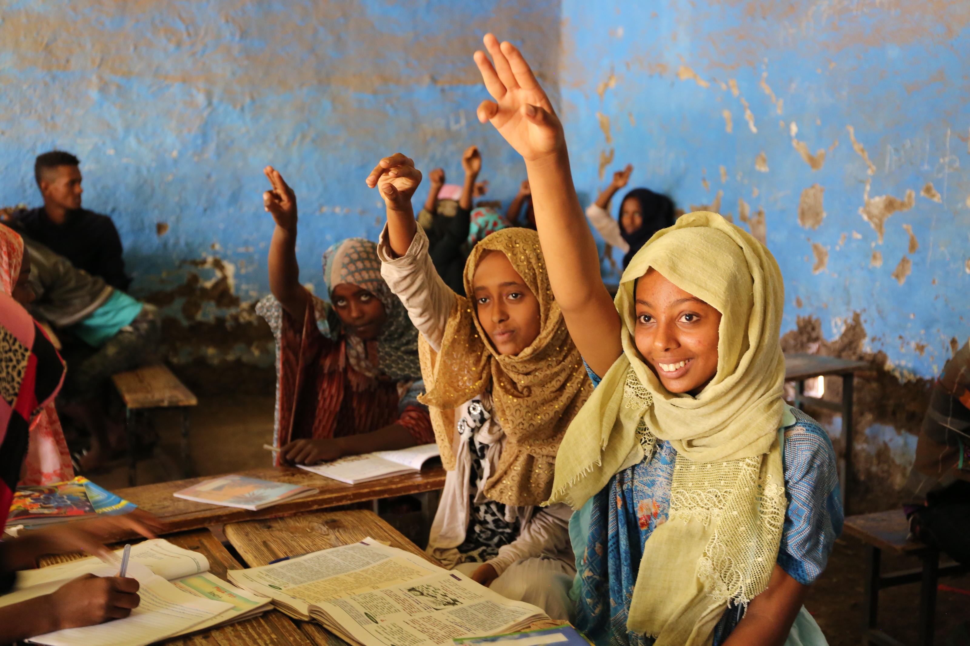Ikram, an eighth grade student and member of the Hygiene and Sanitation Club, puts her hand up in class at her primary school in South Welo, Amhara, Ethiopia.